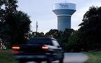 A truck drives down a rural road near a water tower marking the location of the Memphis Regional Megasite on Sept. 24, 2021, in Stanton, Tenn. Ford Mo