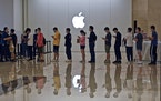 People line up at an Apple Store to buy the latest iPhone 13 handsets in Nanning in south China's Guangxi Zhuang Autonomous Region on Sept. 24, 2021