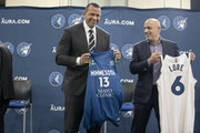 New Timberwolves owners Alex Rodriguez and Marc Lore stood on stage while majority owner Glen Taylor walked off.