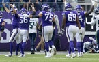 Minnesota Vikings quarterback Kirk Cousins (8) celebrated after throwing a touchdown to Adam Thielen in the second quarter.