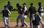 Chicago White Sox's Jose Abreu is held back by teammates during a bench clearing against the Detroit Tigers in the ninth inning.