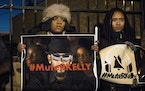 FILE - #MuteRKelly supporters protest outside R. Kelly's studio, Wednesday, Jan. 9, 2019, in Chicago. Accusers and others demanding accountability f