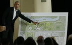In this May 3, 2017, file photo, former President Barack Obama points to a rendering for the former president's lakefront presidential center at a c