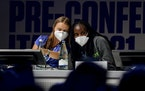 Swedish climate activist Greta Thunberg, left, and Ugandan climate activist Vanessa Nakate share a word as they attend a Youth for Climate summit in M