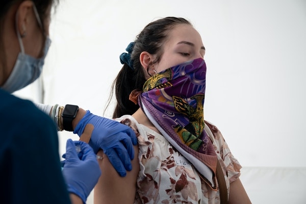 Administering a shot at a community vaccination and testing site in San Francisco on Aug. 1, 2021.