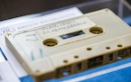 FILE - In this Friday, Sept. 24, 2021 file photo, a view of a cassette with the recording of four Danish schoolboys' interviews with John Lennon and