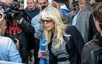 In this Sept. 24, 2013 file photo, Dina Lohan leaves court in Hempstead, N.Y., after pleading not guilty to drunken driving charges. Lohan pleaded gui