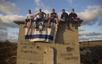 Israelis gather in Ashdod, Israel, to watch the Iron Dome missile defense system as it launches to intercept rocket fire from the Gaza Strip on May 17