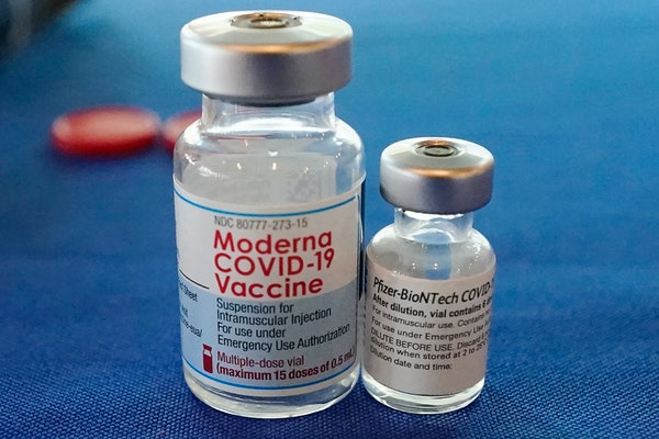 This Sept. 21, 2021 file photo shows vials of the Pfizer and Moderna COVID-19 vaccines.