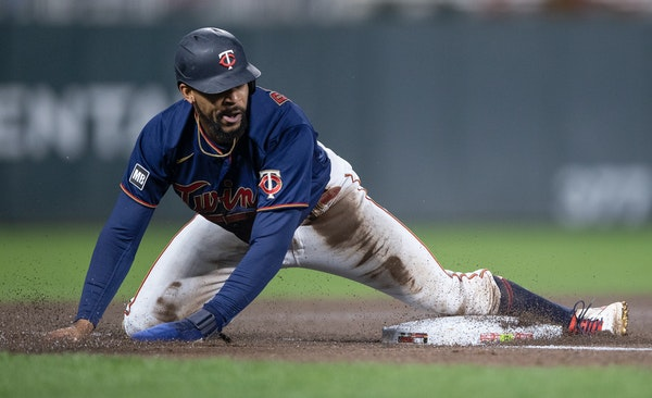 Twins star Byron Buxton pulled himself up after sliding into third base in the third inning Tuesday night at Target Field.
