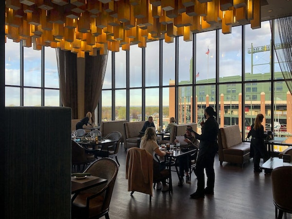 Grab a drink or a dinner at Taverne in the Sky, located on the fifth floor of Lodge Kohler, with views of Lambeau Field in Green Bay, Wis.