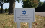 A temporary placard marks Sid Hartman's grave at the Minneapolis Jewish Cemetery.