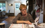 Monika Dipert looked through paperwork she has been collecting about the contaminated water in her home in Andover, Minn., on Thursday, September 23,