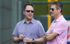 Minnesota Twins executive vice president and chief baseball officer Derek Falvey and  senior VP and general manager Thad Levine.       ] CARLOS GO
