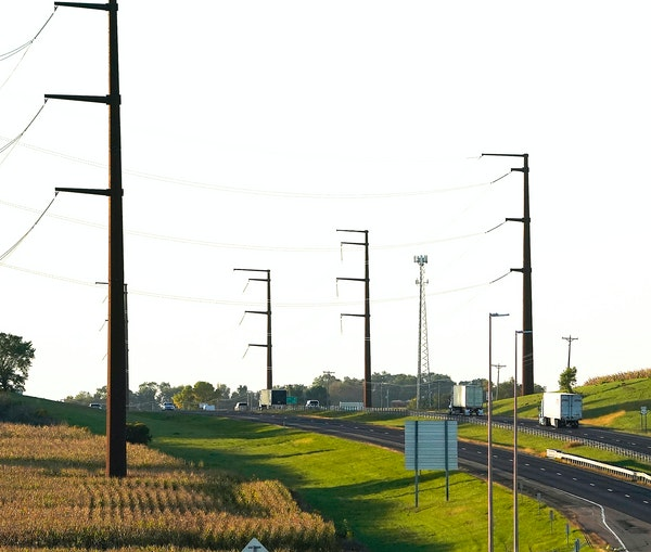 Big transmission lines run along Highway 52, across the farmland and seen Wednesday outside Hampton. ] DAVID JOLES • david.joles@startribune.com Wed