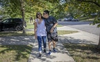 Michael Leseman gave his mother, Pat, a hug as they went on a walk in their St. Paul neighborhood. Pat says the isolation of the pandemic has been har