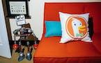 A pillow bearing the logo of DuckDuckGo