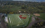 Proctor's Terry Egerdahl field is lit up on Thursday night for a High School Soccer game. Proctor, a small town on a hill west of Duluth, reels in t