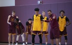 Gophers coach Ben Johnson explained a drill to guard Eylijah Stephens at practice.