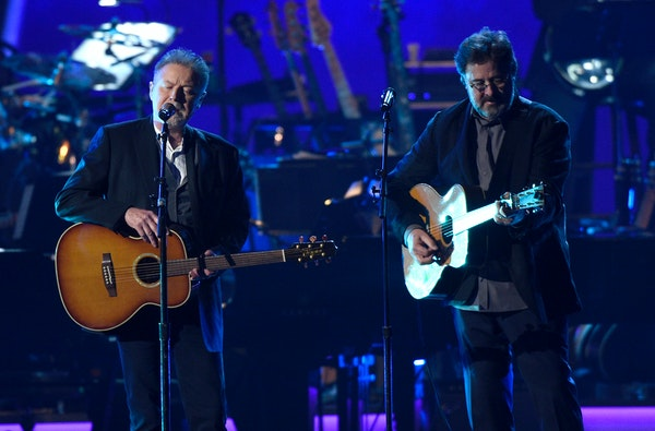 Don Henley, left, and Vince Gill performing in 2019 in Los Angeles.