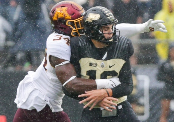 Gophers defensive lineman Boye Mafe pulled down Purdue quarterback Aidan O'Connell for a first-quarter sack Saturday in West Lafayette, Ind.