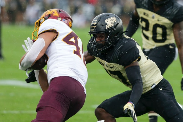 Gophers running back Bryan Williams was tackled by Purdue safety Chris Jefferson after a short first-quarter run. The Gophers failed to produce a 100-