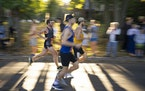 Spectators cheered leading runners along as they passed by on E. Lake Harriet Parkway on Sunday morning.