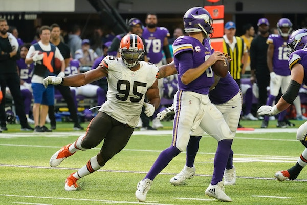 Browns defensive end Myles Garrett (95) closed in on Vikings quarterback Kirk Cousins during the second half Sunday.