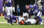 Minnesota Vikings quarterback Kirk Cousins (8) was forced too through and incomplete pass by Cleveland Browns defensive tackle Malik McDowell (58) lat