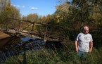 Daniel Ring recently showed how the bridge has collapsed into the Willow River. The abandoned span is on his property in Sturgeon Lake.