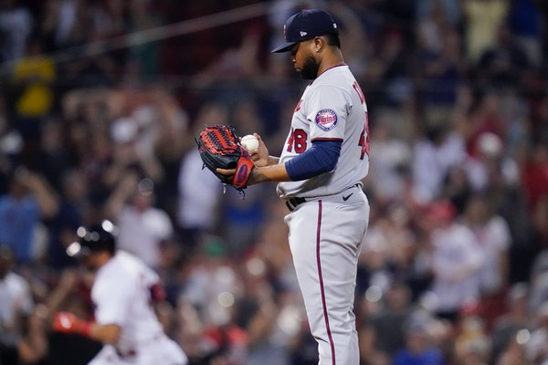 Alex Colome looks down at a fresh baseball after giving up a two-run home during the ninth inning of a game at Fenway Park in August.