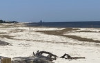 Beaches were still filled with debris and erosion from Hurricane Ida in Pass Christian, Miss., Sunday, Sept. 26, 2021.