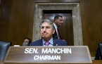 Sen. Joe Manchin, D-W.Va., arrived to chair the Senate Energy and Natural Resources Committee, at the Capitol in Washington, Tuesday, Oct. 5, 2021.