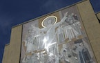 """A mosaic mural nicknamed """"Touchdown Jesus"""" is on the facade of the Hesburgh Library at Notre Dame in South Bend, Ind."""