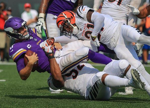 Cincinnati Bengals defensive end Noah Spence (52) and cornerback Mike Hilton (21) sack Minnesota Vikings quarterback Kirk Cousins (8) on Sunday.
