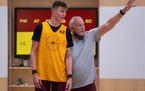 Gophers freshman Treyton Thompson worked with assistant coach Dave Thorson during a drill on the first day of practice, Sept. 28.