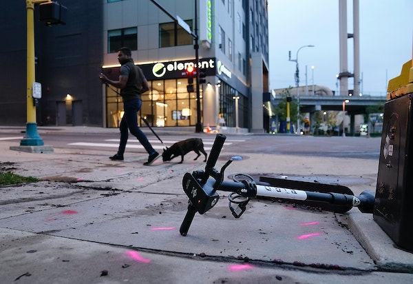 The scene at the intersection of 5th St. N. and 6th Avenue N. where a woman riding a scooter was struck and killed by vehicles involved in a collision