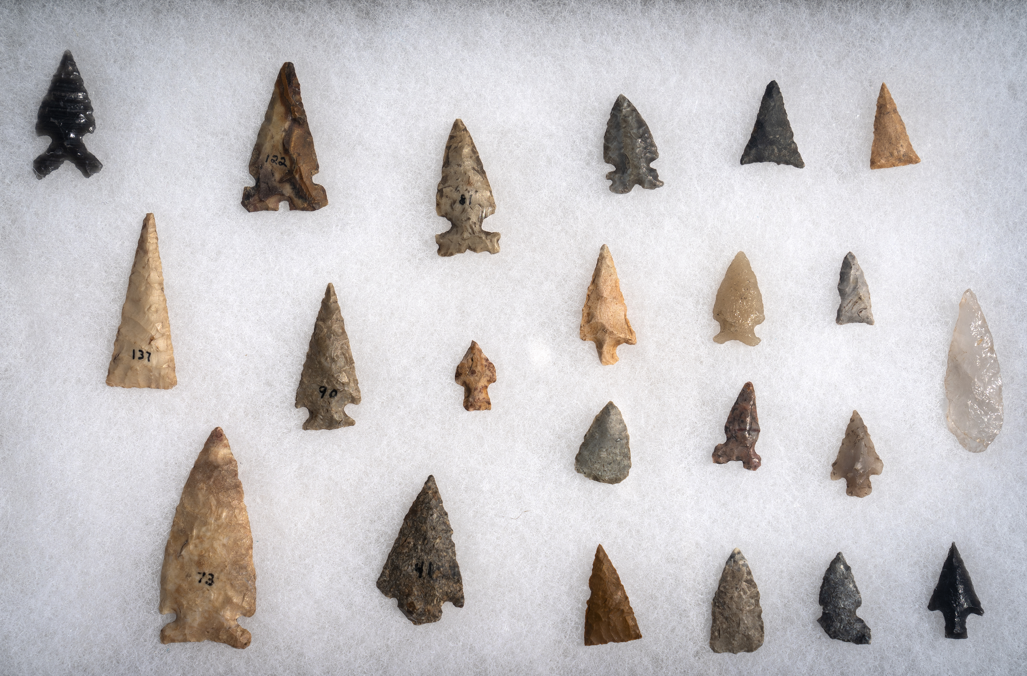 Dakoka and Ojibwe arrowheads and fishing point artifacts found in Minnesota. They are located at Hocokata Ti, a cultural center and gathering space for the Shakopee Mdewakanton Sioux Community.