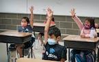 Masked first-grade students in a summer school program at Vista View Elementary School in Burnsville.