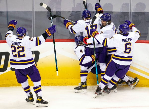 Minnesota State Mankato players celebrated after defenseman Andy Carroll (4) scored a goal to bring the Mavericks to within one in the second period.