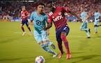 Minnesota United midfielder Emanuel Reynoso (10) and FC Dallas forward Jader Obrian (7) battled for the ball during last Saturday's match in Frisco,