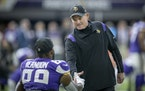 Mike Zimmer greeted tight end Chris Herndon before Sunday's game against Cleveland.