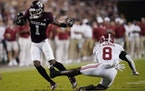 Texas A&M wide receiver Demond Demas gets away from Alabama linebacker Christian Harris during the first quarter