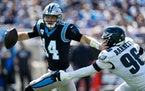 Panthers quarterback Sam Darnold was sacked three times and intercepted three times Sunday against the Eagles.