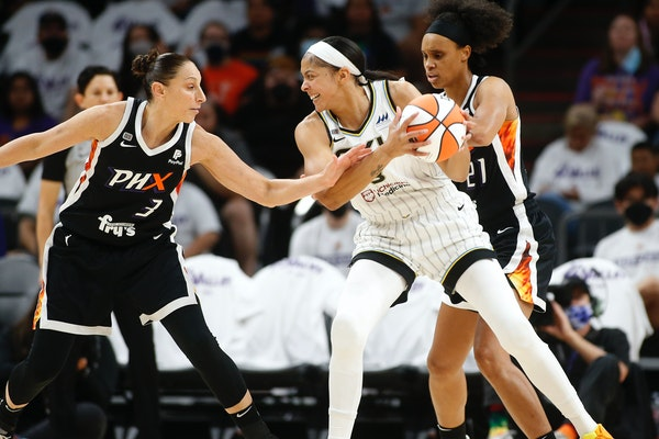 Chicago Sky forward/center Candace Parker looks to pass as Phoenix Mercury guard Diana Taurasi defends during the first half