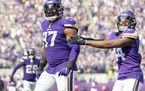 Defensive end Everson Griffen (97) celebrates after sacking Lions quarterback Jared Goff in the first quarter.