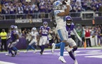 Detroit Lions wide receiver KhaDarel Hodge (18) caught a 2 point conversion over Minnesota Vikings free safety Xavier Woods (23) late in the fourth qu