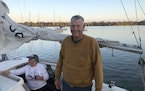 Tim Brandon relaxes after several hours on Lake Nokomis.