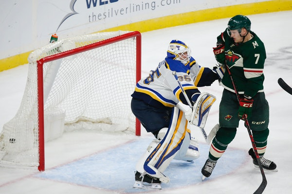 Minnesota Wild center Nico Sturm (7) defects the puck past St. Louis Blues goaltender Ville Husso (35) for a goal to tie the score late in the third p