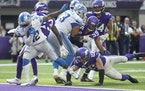 Detroit Lions running back D'Andre Swift (32) broke a tackle of Minnesota Vikings safety Harrison Smith (22) scoring in the fourth quarter.] Jerry H